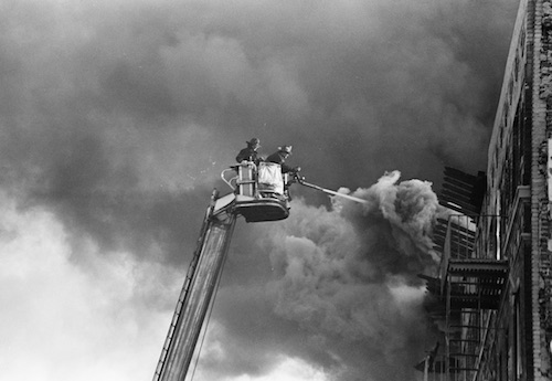 Hi-rise Firefighters spraying water