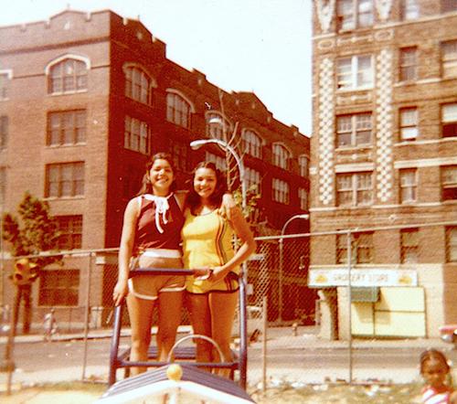 Two women standing in innere city playground