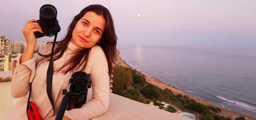 Female photographer overlooking ocean
