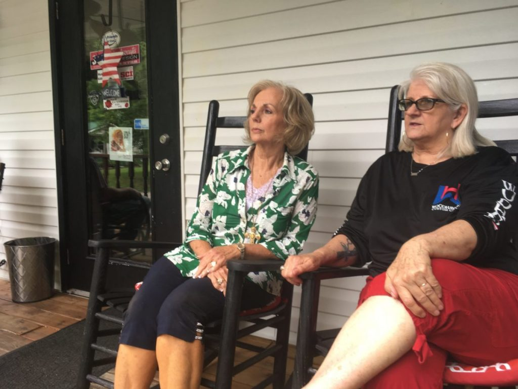 Sisters Judi Casalino (left) and Janie Caudill (right) sit at the hair salon Caudill owns. Both sisters have suffered from flooding: Janie lost her salon in the 2010 flood, and Judi's nearby home has flooded multiple times.