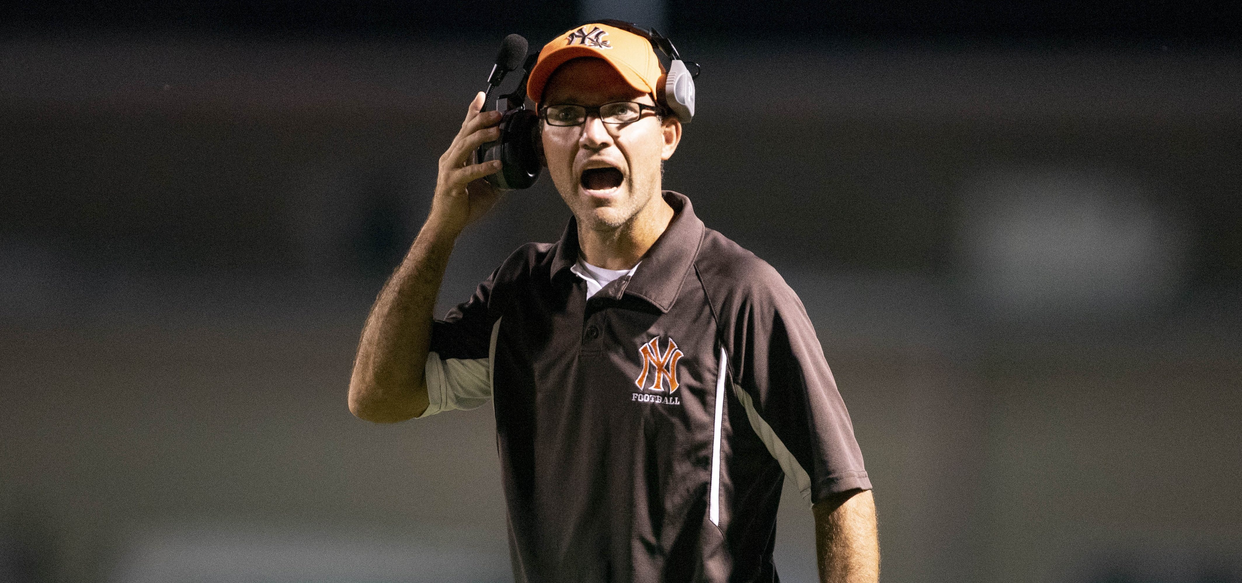 Nelsonville-York head coach Rusty Richards yells to his players during the game against River Valley on Sept. 20, 2019.