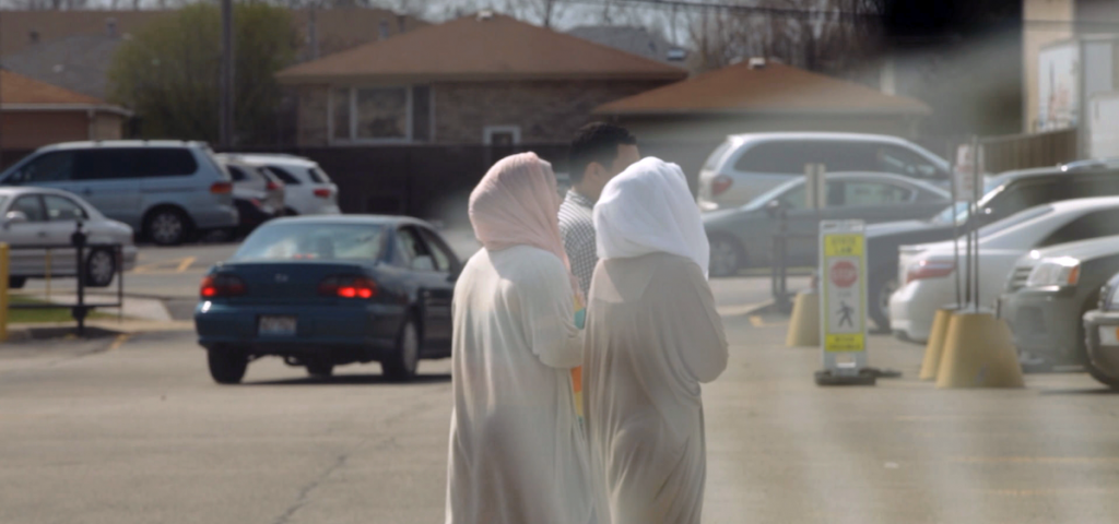 women walking down street with head covers
