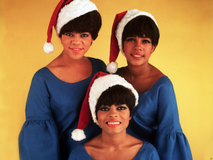 The Supremes in Christmas santa hats