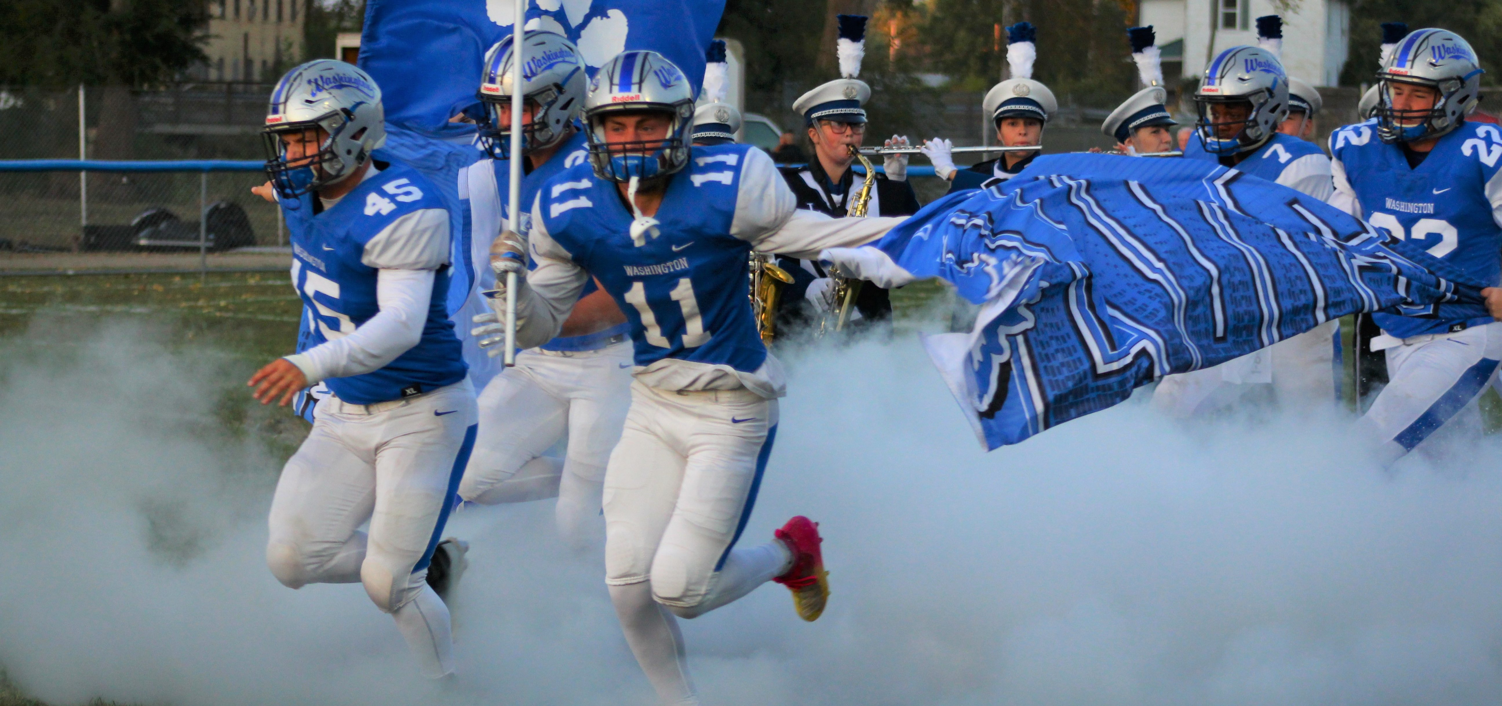 The Chillicothe Cavaliers run onto the field as get set to play the Washington Court House on Oct. 5, 2019.