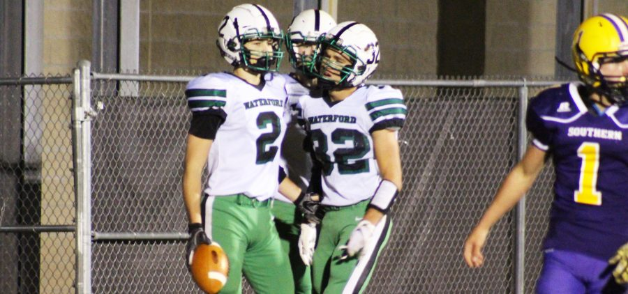 Waterford Wildcat players Joe Pantelidis and Holden Dailey celebrate after scoring a touchdown
