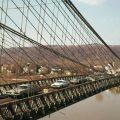 archival photo of cars crossing the Wheeling suspension bridge