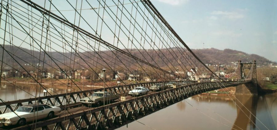 archival photo of cars crossing the Wheeling suspension bridge