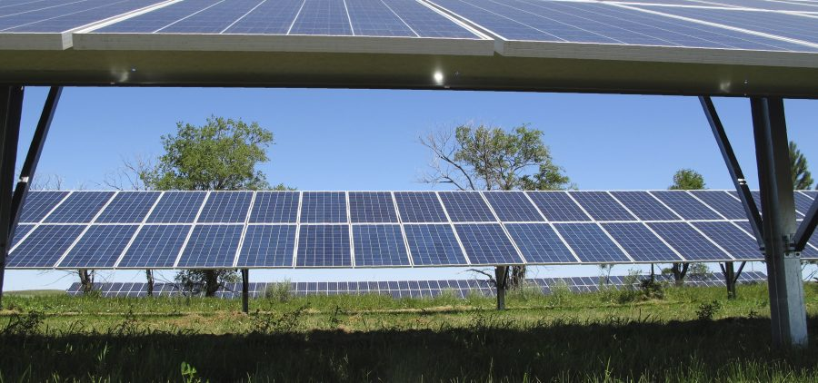 Some of the 1,000 solar panels that are part of a green energy project on the Standing Rock Indian Reservation frame the landscape near Cannon Ball, N.D., where the grand opening for the energy farm that was borne partly out of protests against the Dakota Access pipeline in 2016 and 2017 was held. Revenue generated from the 30 kilowatt farm is currently being used to power a community center and gymnasium in Cannon Ball. (AP Photo/Dave Kolpack)