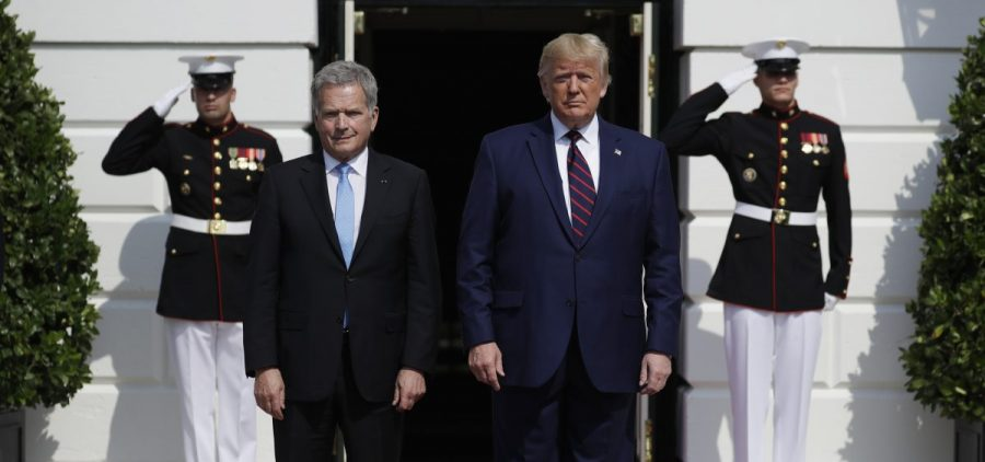 President Trump greets Finnish President Sauli Niinistö on the South Portico of the White House on Wednesday. They are holding a joint press conference amid a building impeachment inquiry into Trump.
