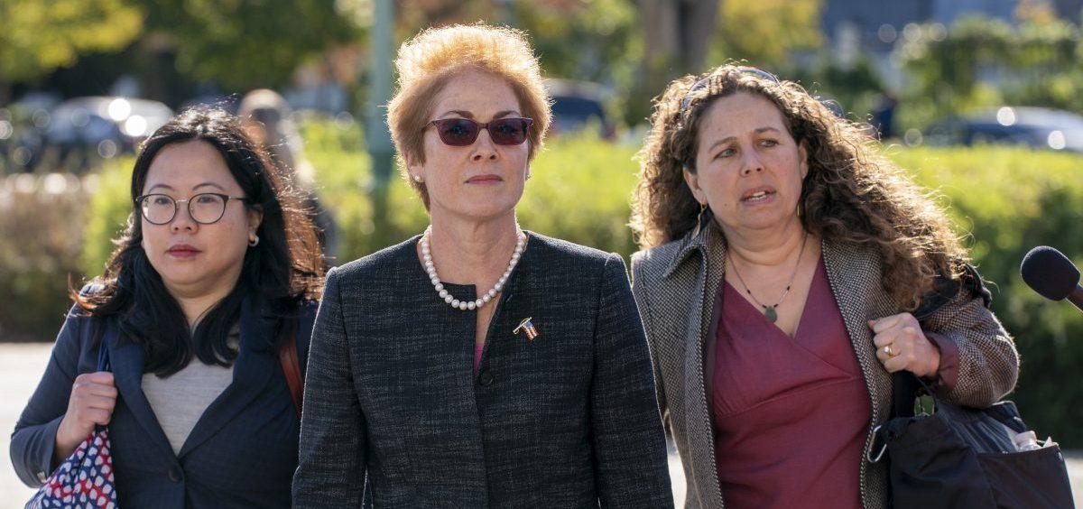 Former U.S. ambassador to Ukraine Marie Yovanovitch (center) arrives on Capitol Hill Friday for congressional testimony.