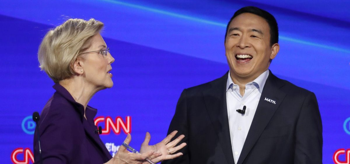 Sen. Elizabeth Warren, D-Mass., and entrepreneur Andrew Yang talk during a break in the Democratic presidential primary debate hosted by CNN/New York Times.