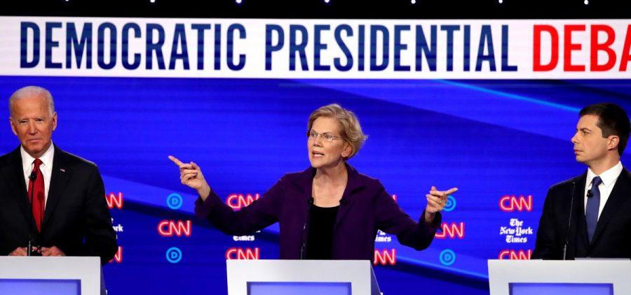 Left to right, former Vice President Joe Biden, Massuchusetts Sen. Elizabeth Warren and South Bend, Ind. Mayor Pete Buttigieg react on stage during the Democratic Presidential Debate at Otterbein University.