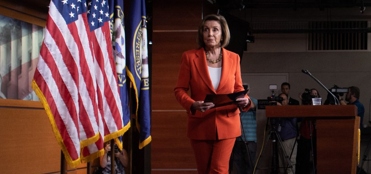 Speaker of the House Nancy Pelosi, D-Calif., leaves after speaking at her weekly press conference on Capitol Hill on Thursday as the House prepared to vote — then pass — a resolution formalizing its impeachment inquiry into President Trump.