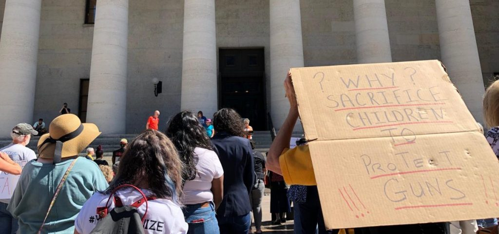 Demonstrators gather during an anti-gun violence march held outside of the Ohio Statehouse. [Andy Chow | Statehouse News Bureau]
