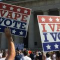 "People hold signs that read ""I Vape, I Vote"" outside the Ohio Statehouse"