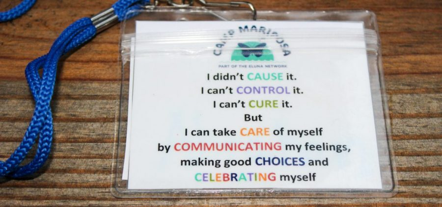 "The lyrics of the Camp Mariposa song, ""7 Cs,"" are printed out on lanyards so first time campers can sing along. One child said, ""It helps me realize that I didn't cause what happened to me. It makes me feel much better."""