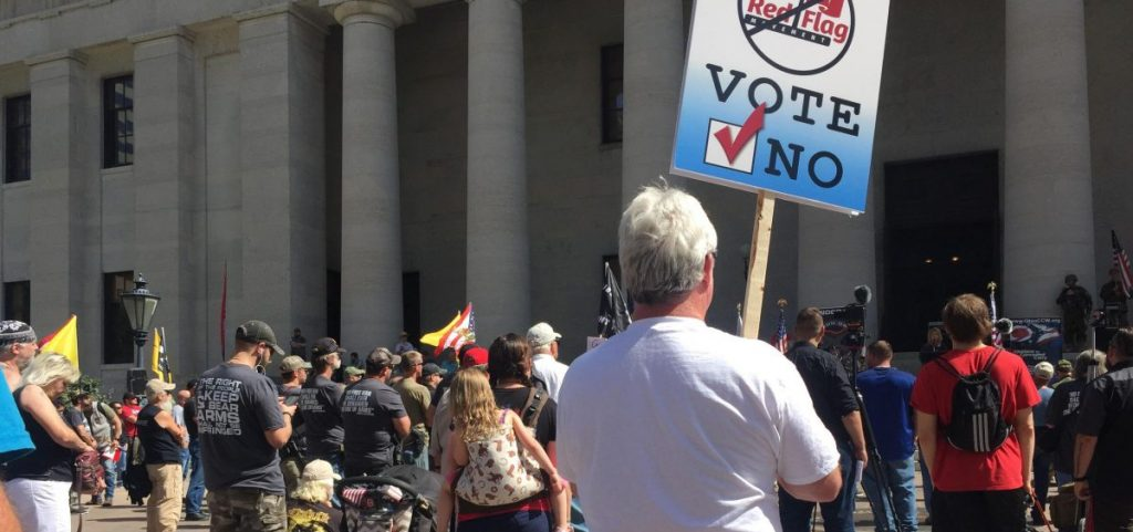 Gun rights advocates rally for an open carry demonstration at the Ohio Statehouse in protest to Gov. Mike DeWine's proposed regulations. [Andy Chow | Statehouse News Bureau]