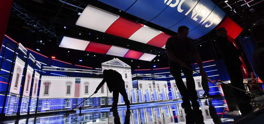 Workers clean the stage ahead of a Democratic presidential primary debate