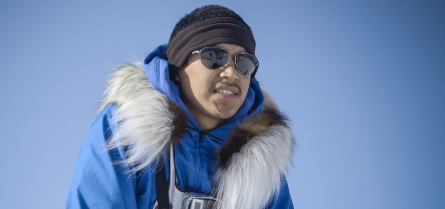 clouse up of musher during dog sled race