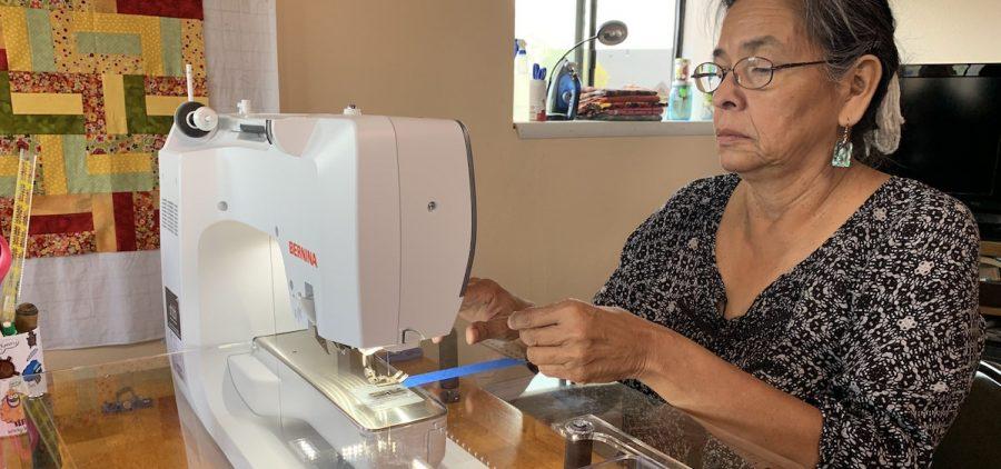 Susan Hudson at her sewing machine.