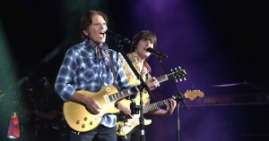 John & Shane Fogerty performing on stage