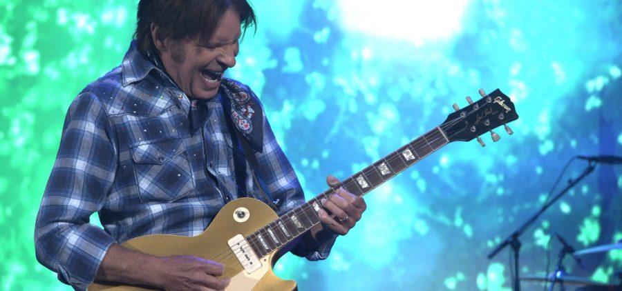 close up of John Fogerty playing guitar