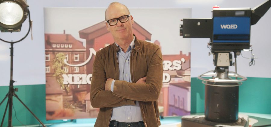 Michael Keaton standing in WQED's Mister Rogers studio