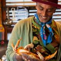 Chef Marcus Samuelsson prepares a crab for a ginataang alimasag