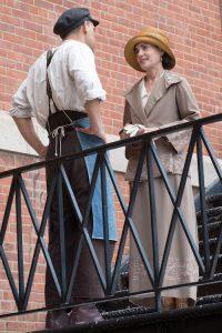 Couple speaking on balcony