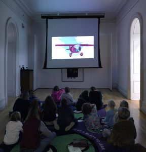 Children watching Xavier Riddle screening at Kennedy Museum