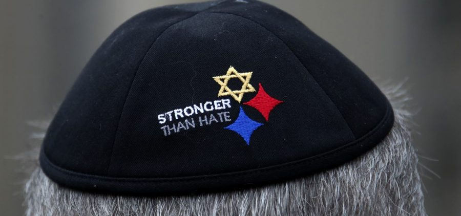 A man wearing a Stronger Than Hate yarmulke stands outside the Tree of Life synagogue in Pittsburgh, the site of a shooting that killed 11 worshippers in 2018. Anti-Semitic homicides in the U.S. reached their highest level ever as a result of the shooting.
