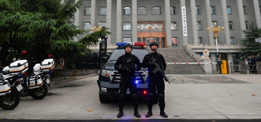 Police stand guard outside the Xingtai Intermediate People's Court in Xingtai, China's Hebei province, which issued stiff prison sentences to nine people caught in an illegal fentanyl ring.