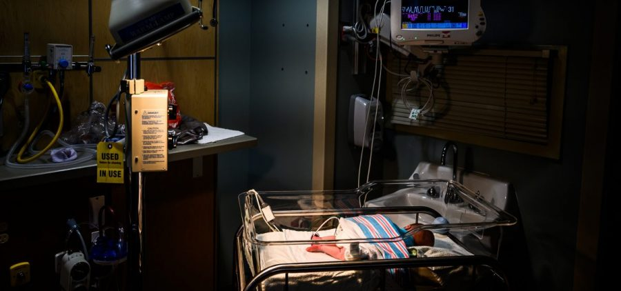 Infants exposed to opioids in utero often experience symptoms of withdrawal. An infant is being monitored for opioid withdrawal inside a neonatal intensive care unit at the CAMC Women and Children's Hospital in June 2019, in Charleston, W.Va.
