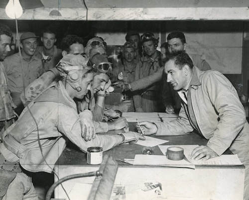 Joseph McCarthy interviewing pilots who have just returned from raids on Japanese installations in the Solomon Islands during World War II.
