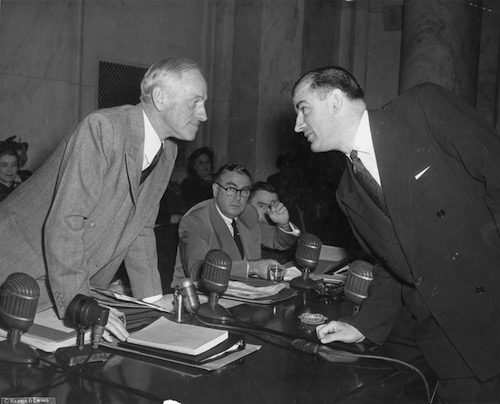 Senator Joseph McCarthy and Senator Millard Tydings [R] Maryland, face off on the first day of hearings into McCarthy's allegations that scores of communists were working in the State Department.