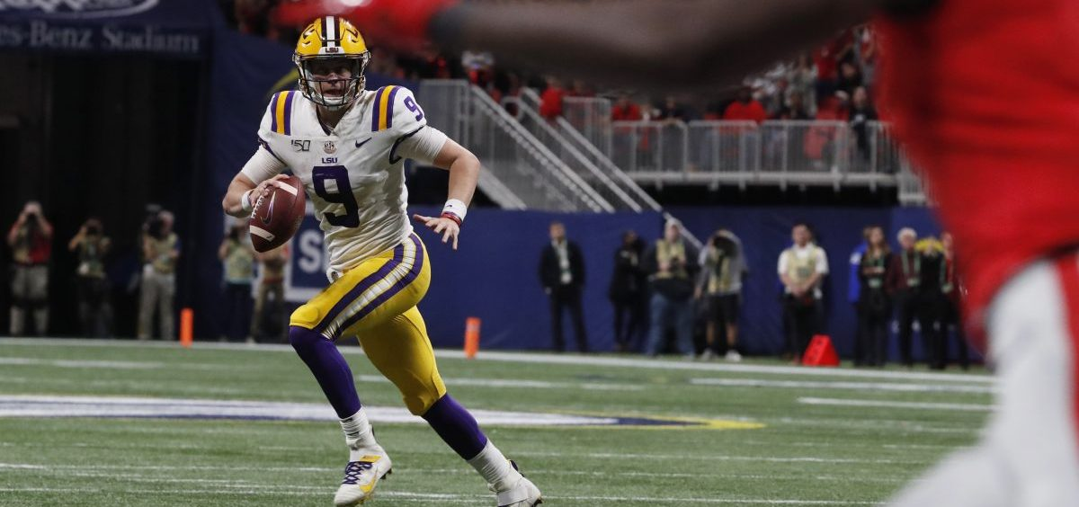 LSU quarterback Joe Burrow (9) runs against Georgia during the first half of the Southeastern Conference championship NCAA college football game, Saturday, Dec. 7, 2019, in Atlanta.