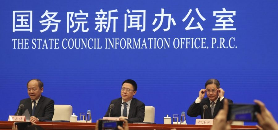 Chinese officials from left Ning Jizhe, Vice Chairman of National Development and Reform Commission, Liao Min, Deputy Director of the Office of the Central Commission for Financial and Economic Affairs and Vice Minister of Finance, Zheng Zeguang, Vice Minister of Foreign Affairs attend a press conference on the trade deal with the United States in Beijing on Friday, Dec. 13, 2019.