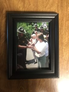 Photos depicting Coal River Mountain Watch's history of grassroots activism hang in the office