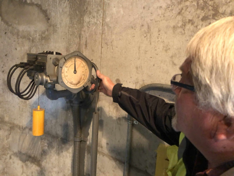 Mike Pemberton shows a dated sensor that uses mercury in Pump Station Number Six in Ironton, Ohio.