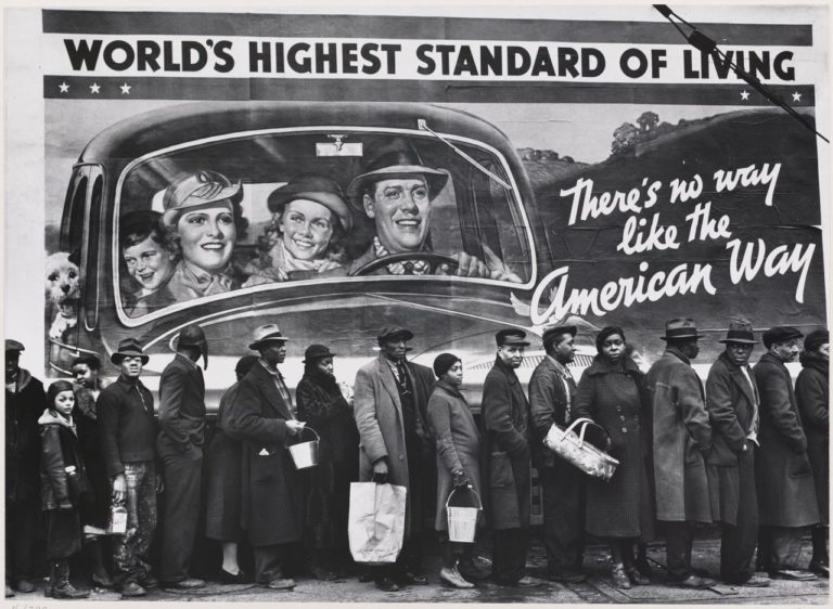 Margaret Bourke-White photographed flood victims in Louisville, Kentucky, awaiting relief supplies, an iconic image of the 1937 Ohio River flood.