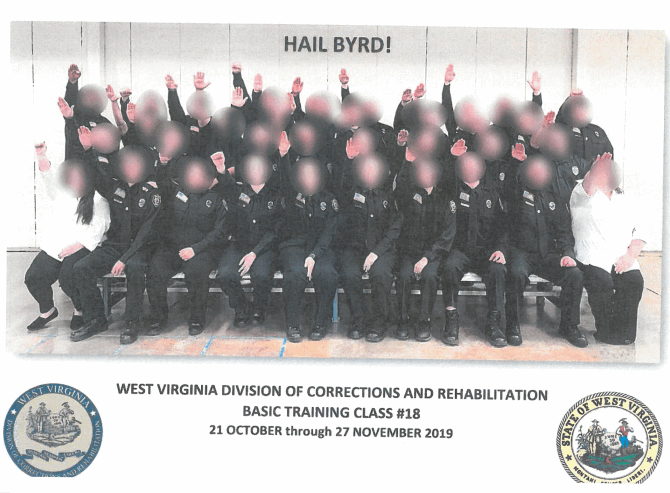 A photo shows a training class giving what appears to be a Nazi salute