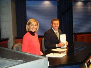 Sara Shookman sitting on WOUB Newswatch set