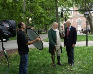 Douglas H. Ginsburg, Judge, U.S. Court of Appeals, D.C. Circuit, talks with historic interpretive actor Benjamin Franklin outside of Independence Hall in Philadelphia, Pennsylvania