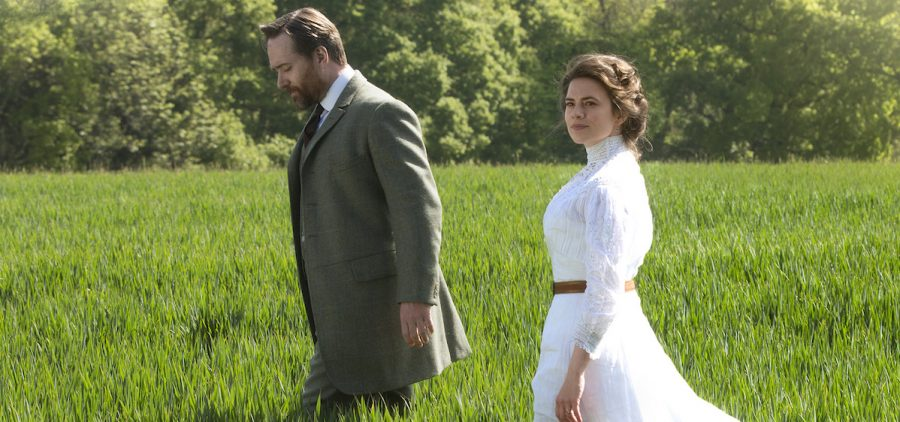Howards End couple walking in high grass