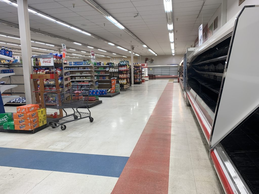 The empty deli counter and bare shelves of the Inez, KY, IGA.