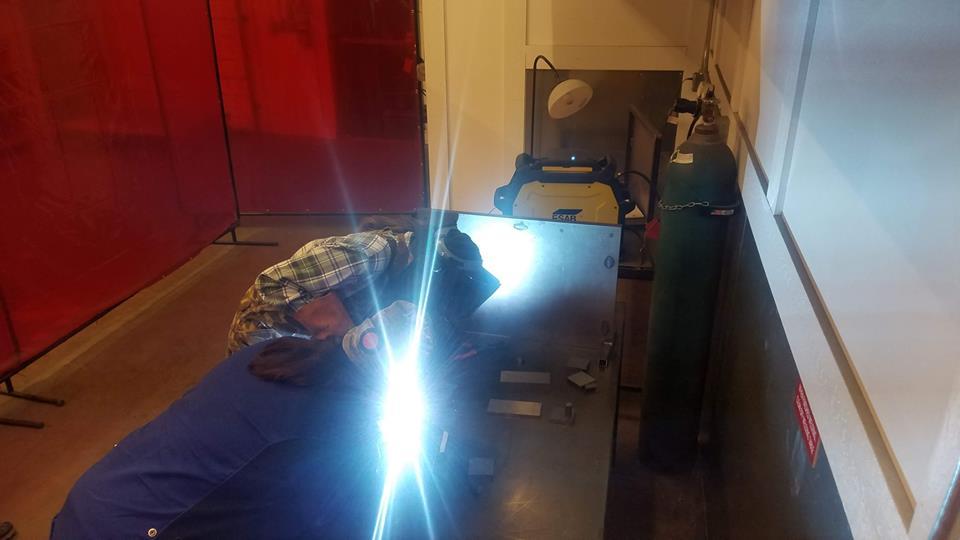 Someone operates a welding machine