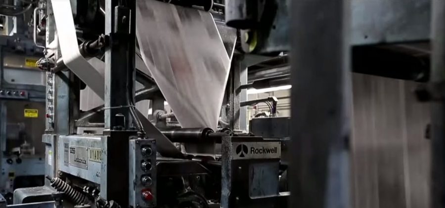 A printing press runs papers