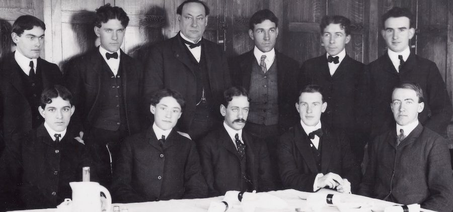 group of men in suits seated at table facing camera, early 190ss