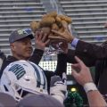 Bobcats Head Coach Frank Solich lifts the Potato Bowl trophy following Ohio's 30-21 win over Nevada on January 3, 2020.