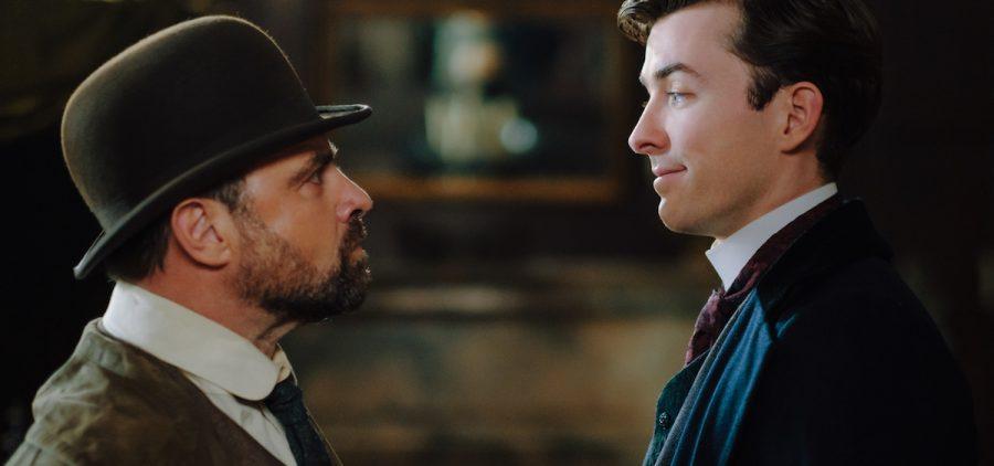 Max stares and Oskar smiles.(Film 1) [Actors –left to rightJuergen Maurer, Matthew Beard]